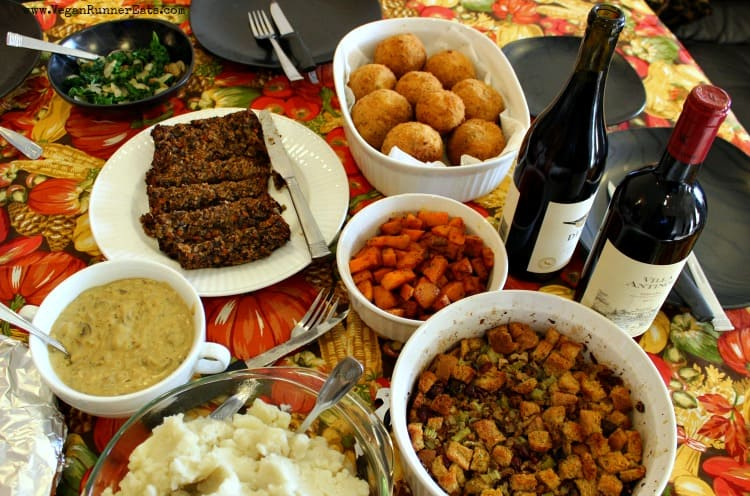 A vegan Thanksgiving table with sausage-stuffed Italian rice balls.
