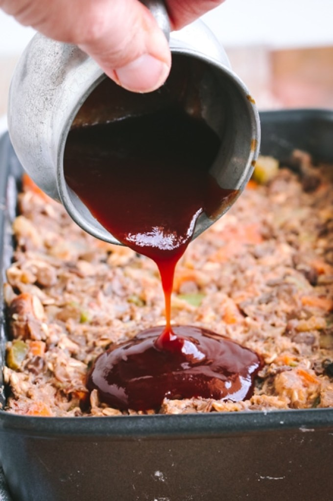 Picture of Maple Balsamic Glaze Being Poured over Vegan Lentil Loaf