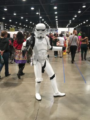 """A Stormtrooper who was enjoying his convention by dancing to Taylor Swift's """"Shake It Off"""", which was playing from the speaker attached to the right-side of his belt"""