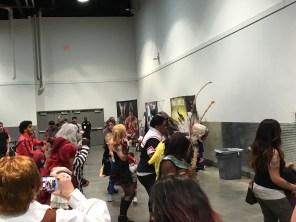 Cosplayers gather and dance together to the wobble, as many others are entertained
