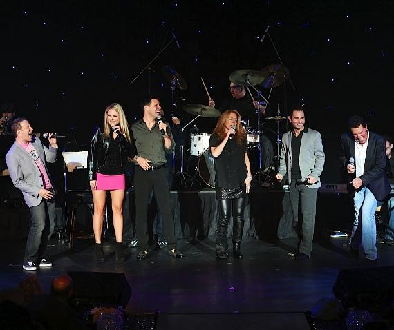 """(From left to right) Martin Kaye and Felice Garcia from Million Dollar Quartet at Harrah's Las Vegas, Frankie Moreno, event co-host Kelly Clinton, Travis Cloer from Jersey Boys at Paris Las Vegas and Cabaret Jazz headliner Clint Holmes conclude the """"Headliners Bash"""" with their rendition of  """"With a Little Help from My Friends."""""""