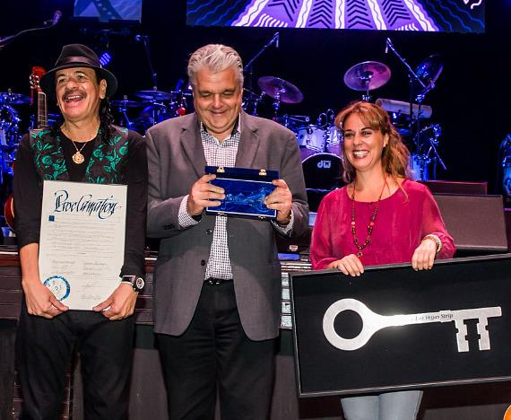 Carlos Santana, Clark County Commissioner Steve Sisolak and Roxana Drexel, Hermes Music Foundatio