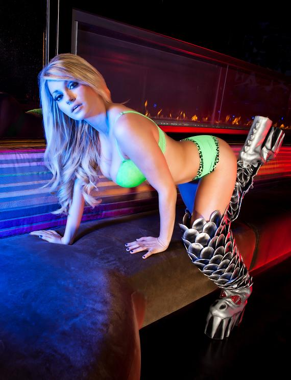 Star of Absinthe, Angel Porrino, reveals the sensual side of the official KISS boots that are currently touring Las Vegas in celebration of the upcoming opening of KISS by Monster Mini Golf.  On the heels of the announcement about KISS by Monster Mini Golf opening in March 2012, the KISS boots have been brought to Vegas for a limited engagement throughout the city.