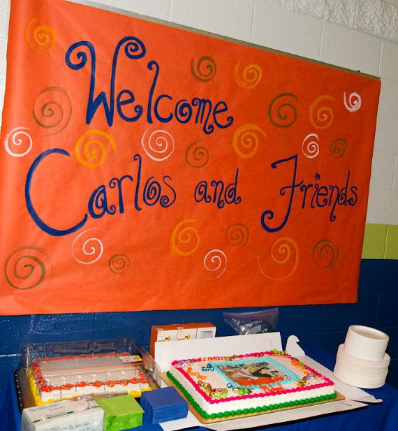 Welcome sign for Carlos and band members