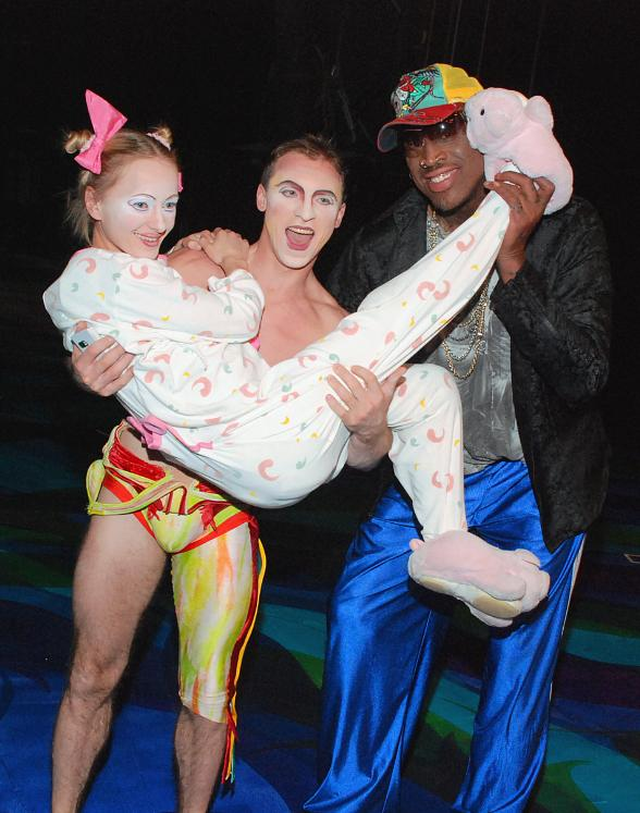 """Dennis Rodman with the """"Baby Girl"""" and a Highbar Artist from Mystère by Cirque du Soleil at Treasure Island Las Vegas"""