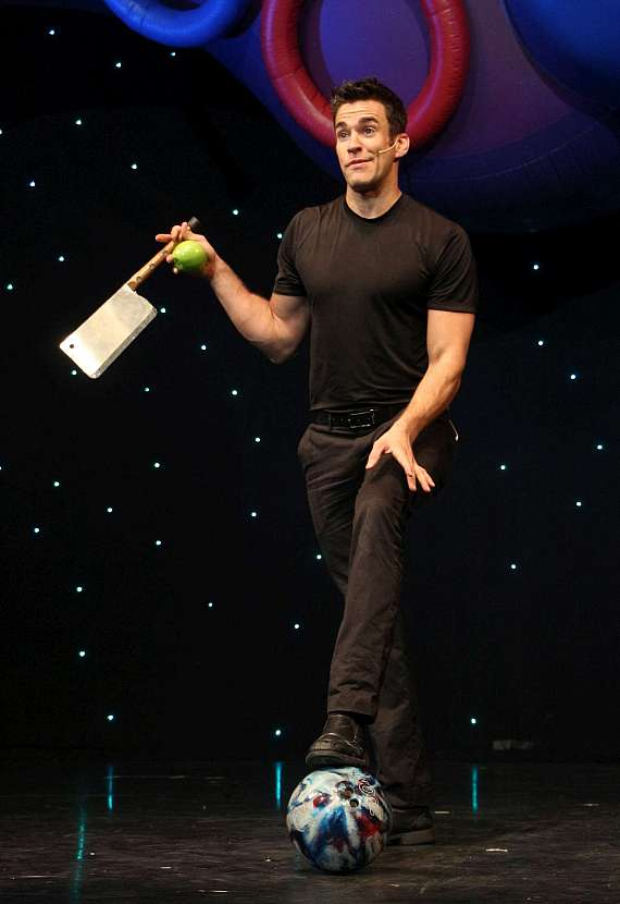 Jeff Civillico perpares to juggle a cleaver, an apple and a bowling ball