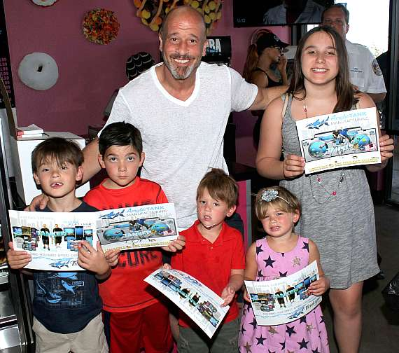 """""""Tanked"""" star and Donut Mania owner Brett Raymer with young fans"""