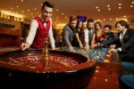 The,Croupier,Holds,A,Roulette,Ball,In,A,Casino,In