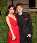 Selena Gomez and Justin Bieber arrive arm in arm at The Vanity Fair Oscar Party in Los Angeles, CA