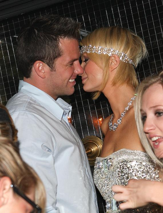 Paris Hilton and Doug Reinhardt sneak a kiss