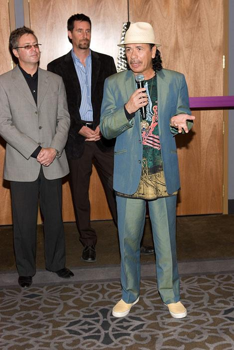 Randy Kwasniewsk, Paul Davis (VP of Entertainment for Hard Rock Hotel & Casino) and Carlos Santana