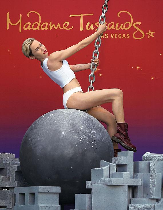 Madame Tussauds debuts their Miley Cyrus wax figure atop a wrecking ball at The Venetian Las Vegas on March 9, 2015 in Las Vegas, Nevada