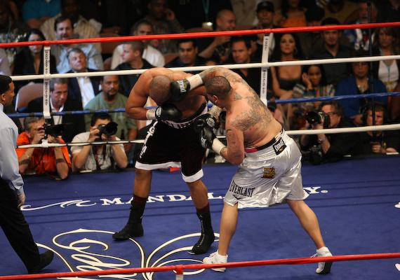 Chris Arreola delivers a over hand right to Jameel McCline at the Mandalay Bay Events Center