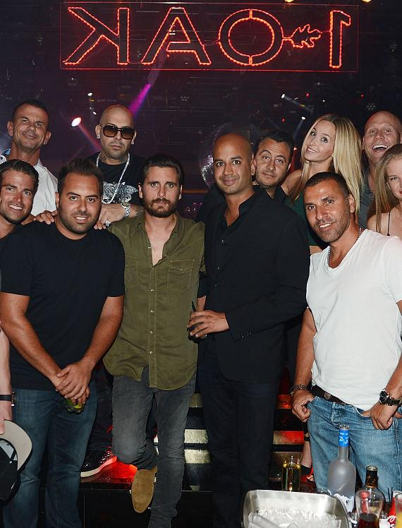 Scott Disick poses for a photo with friends at 1 OAK Nightclub at The Mirage Hotel & Casino