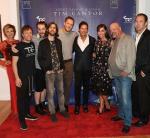 Heidi Leigh, Imagion Dragons bass guitarist Ben McKee, drummer Daniel Platzman, guitarist Daniel Wayne and singer Dan Reynolds pose for a photo with artist Tim Cantor, Amy Cantor, Rick Harrison and Chad Sampson at Tim Cantor's Las Vegas art exhibit at AFA Gallery
