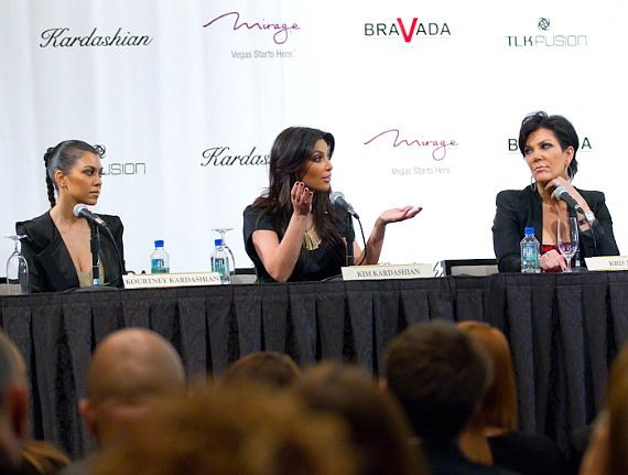 Kourtney and Kim Kardashian with mom, Kris Jenner