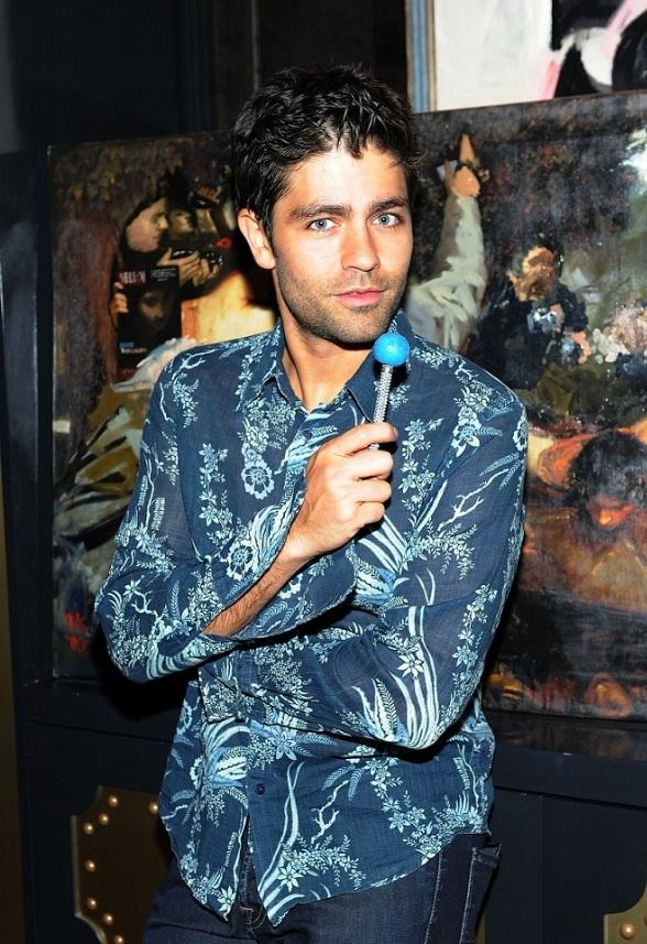 Adrian Grenier posing with a couture pop in the chocolate lounge