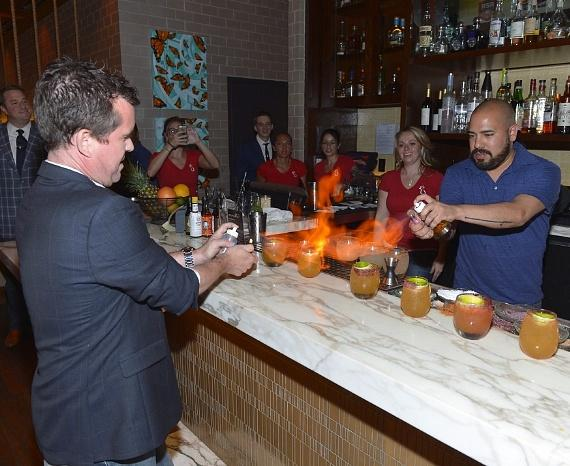 """Paul Tanguay and Paul Sauter from The Tippling Bros. light the bar on fire with the signature drink """"Big Nose Goes to Mexico"""""""