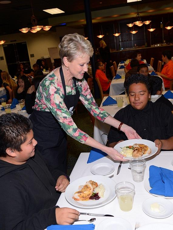 Paula Francis from Channel 8 serves Thanksgiving meals