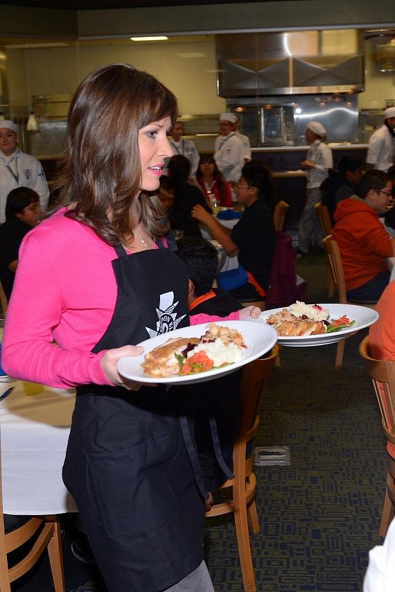 Beth Fischer of Channel 13 serves Thanksgiving lunches