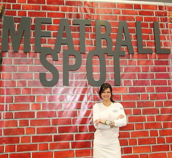 Carla Pellegrino in front of Pop-Up Meatball Spot sign at the Consumer Electronics Show
