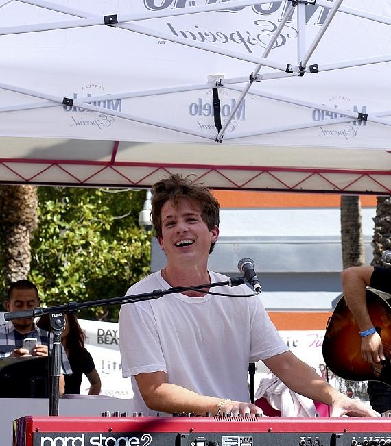 Charlie Puth performs on stage as fans sing along at Flamingo GO Pool on Saturday, July 16, in Las Vegas
