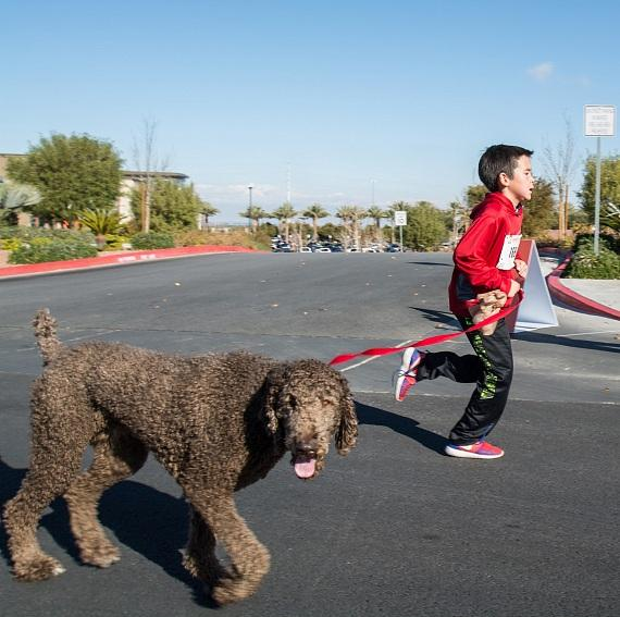 Child and dog finishing the 5K at Life Time Green Valley