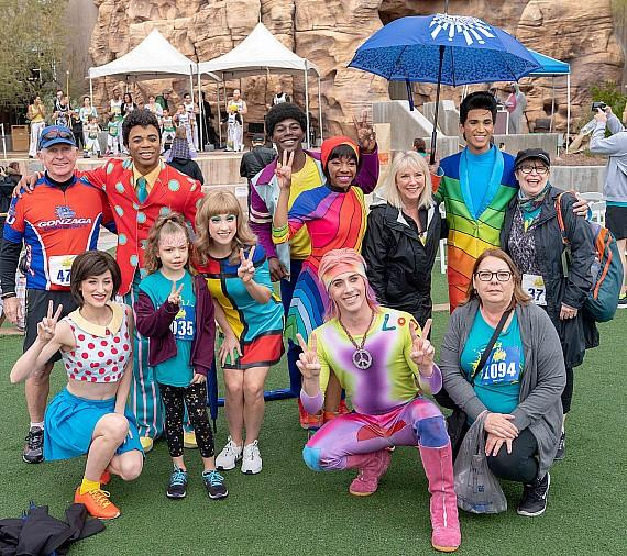 "Cirque du Soleil artists pose with ""Run Away with Cirque du Soleil"" costume contest participants"