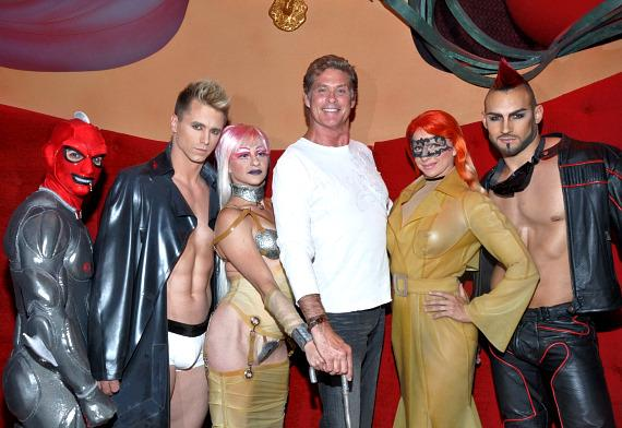 David Hasselhoff poses with the sexy artists of Zumanity – The Sensual Side of Cirque du Soleil at New York-New York while attending the show on Sunday, July 24