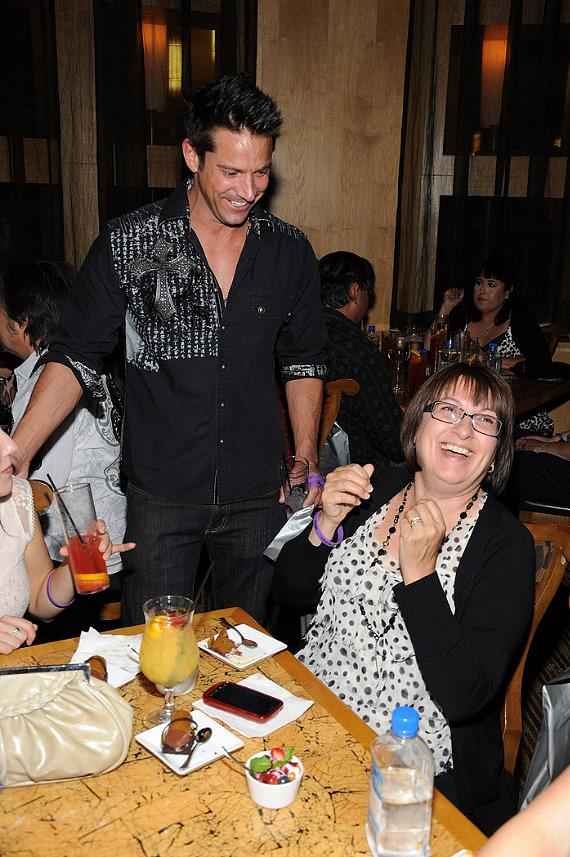 "Jeff Timmons and guest at ""Ultimate FANTASY"" calendar party in Rice & Company at Luxor"