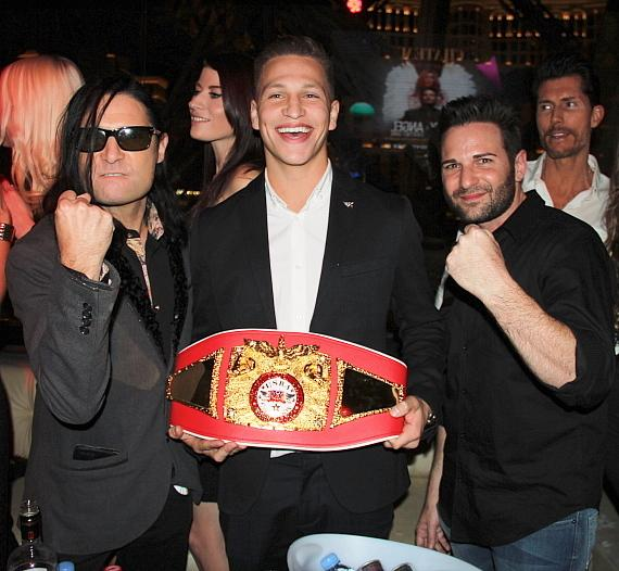 Feldman and Franco posing with the USBA title belt