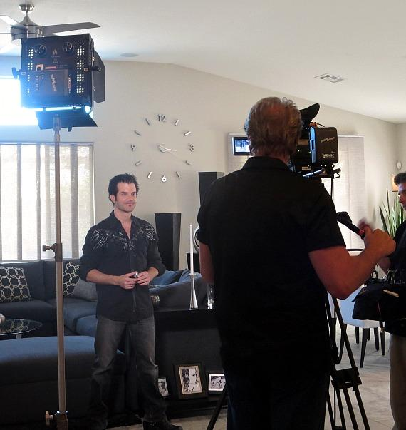 Kyle films a promotional spot for the show in Kyle & Mistie's home