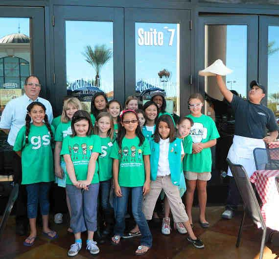 The Girl Scouts pictured with Carl Zwick, manager of Grimaldi's Pizzeria in Boca Park Fashion Village and Isaias Ramirez, kitchen manager earned their Simple Meals Badge on Saturday Oct. 20 at Grimaldi's Pizzeria.
