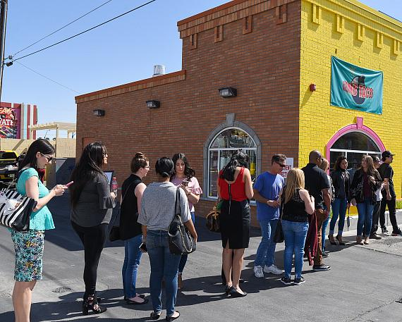 Guests line up to receive complimentary taco and drink