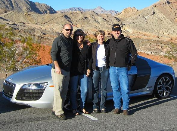 Dave, Andy and their wives with an Audi R8 V10