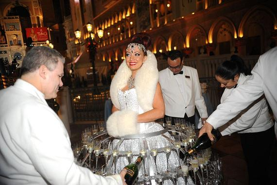 Champagne dress being filled at The Venetian's Winter in Venice celebration