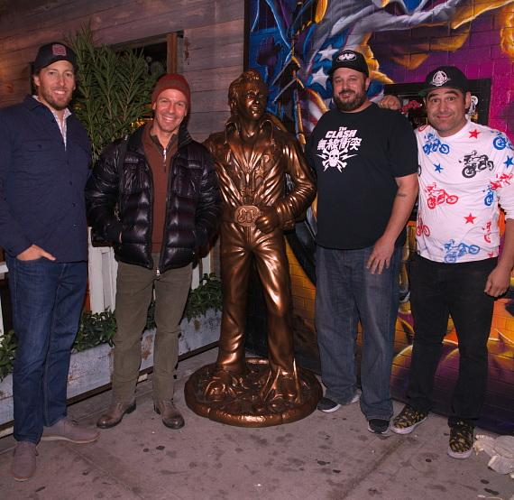 Jeff Fine, Seth Schorr, Branden Powers and Vincent Rotolo pose with Evel Knievel statue