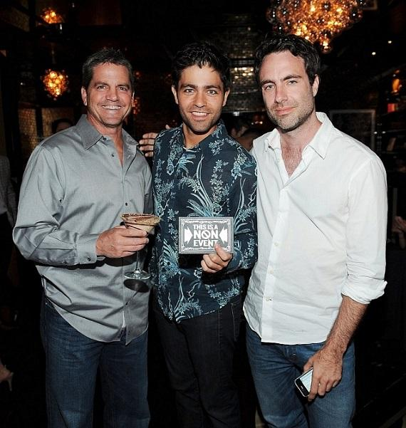 Adrian Grenier posing with executive producers John Loar and Matthew Cook