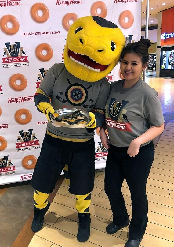 Team mascot Chance the Gila Monster with member of Krispy Kreme Donuts at Excalibur Hotel in Las Vegas