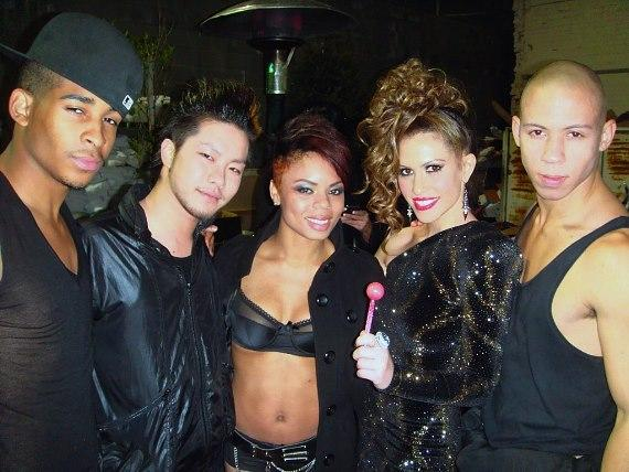 Kimberly Cole, posing with her Couture Pop,and a group of her dancers backstage