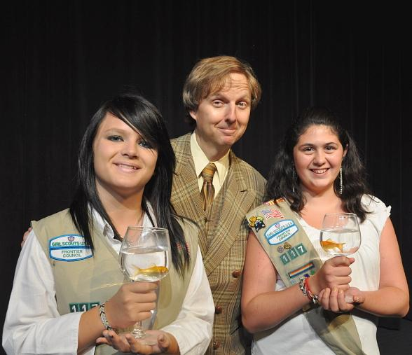 Comedy-magician Mac King and goldfish pose with Cadette Girl Scouts Ashley Smith and Megan Philippi after the show.