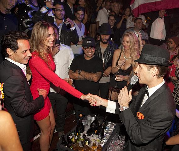 Marc Anthony and girlfriend