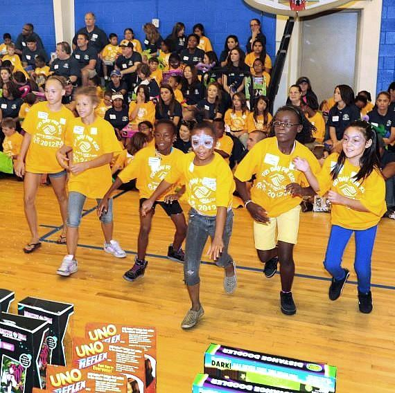 Kids rush to pick their prizes during Fun Day for Kids