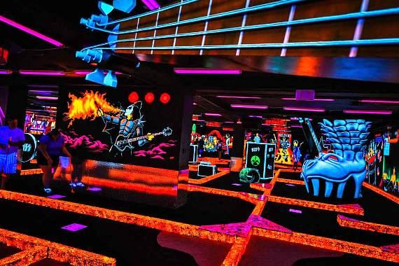 """KISS By Monster Mini Golf is a 14,000 square-foot """"KISS themed"""" attraction that showcases an indoor glow-in-the-dark custom-designed, rockin' 18-hole miniature golf course filled with state-of-the-art video & animatronics, and never-seen-before KISS props"""
