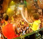 Redfoo pops champagne during Party Rock Monday at Marquee