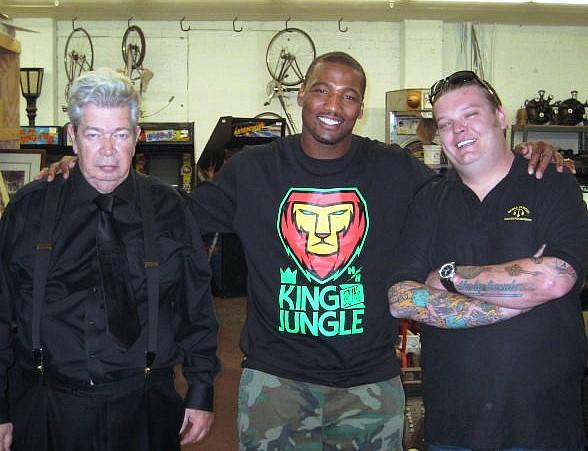 """San Diego Charger Shaun Phillips (c) visits the """"Pawn Stars"""" Old Man (l) and Corey """"Big Hoss"""" Harrison at Gold & Silver Pawn"""