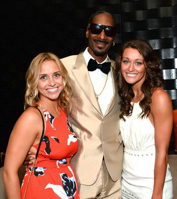 Snoop Dogg poses with fans at The Snoopadelic Cabaret