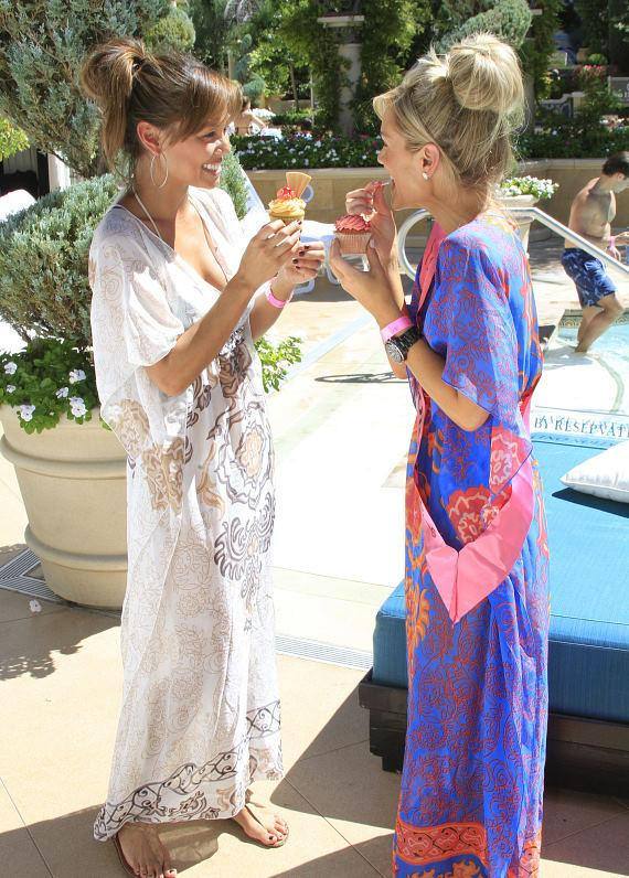 Vanessa and Jennifer eating cupcakes, both wearing Hale Bob coverups