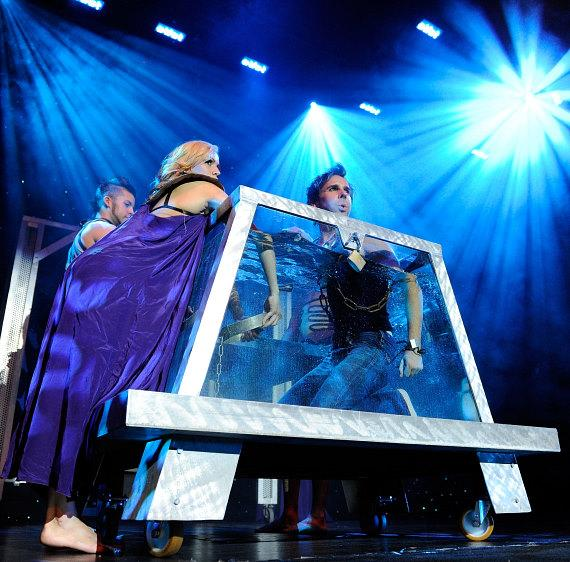 """Jan Rouven prepares to """"dive-in"""" to his famous Water Tank illusion onstage during the Grand Opening of his new show ILLUSIONS in Las Vegas"""