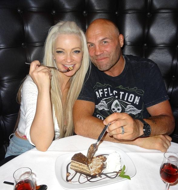 """Actor/MMA Legend Randy """"The Natural"""" Couture and Actress Mindy Robinson dine at Andiamo Italian Steakhouse inside the D Casino Hotel"""